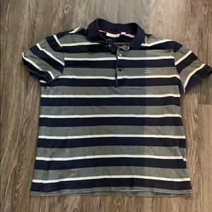 Lacoste Men's polo size 5 / L, fits more like a M.